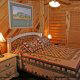 Country Bedroom View of Cabin 22 (Beaver Lodge) at Eagles Ridge Resort at Pigeon Forge, Tennessee.