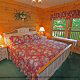 This charming bedroom has that country view in cabin 80 (Heavenly Haven), in Pigeon Forge, Tennessee.
