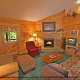 Relax in this lounge chair in the attractive living room in cabin 80 (Heavenly Haven), in Pigeon Forge, Tennessee.