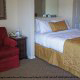 Queen size bed and suite at The Suites At Fall Creek in Branson Missouri.