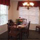 Warmly decorated dining room at The Suites At Fall Creek in Branson Missouri.