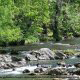River View from Balcony at Pigeon River Inn in Pigeon Forge, TN. Listen to the peaceful whisper of the river while on Spring Break Family Vacation.