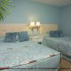 Double beds of a 1 bedroom condo in tropical pastel colors at the Star Island Resort and Club in Orlando Florida.