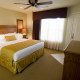 The Suites at Fall Creek king bed room