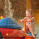 Toddler enjoys cooling off in water park at the Wilderness Stone Hill Lodge in Pigeon Forge Tennessee.