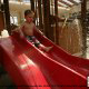 Toddler enjoys a water slide at the Wilderness Stone Hill Lodge in Pigeon Forge Tennessee.