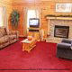 Living room with fireplace in cabin 101 (Heavenly Hideaway) at Eagles Ridge Resort at Pigeon Forge, Tennessee.