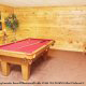 Game room with pool table in cabin 101 (Heavenly Hideaway) at Eagles Ridge Resort at Pigeon Forge, Tennessee.