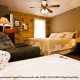 Country Bedroom with Jacuzzi in Cabin 15 (A Bears Life) at Eagles Ridge Resort at Pigeon Forge, Tennessee.