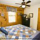 Bedroom with TV Set in Cabin 15 (A Bears Life) at Eagles Ridge Resort at Pigeon Forge, Tennessee.
