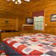 Bedroom View with TV Set of Cabin 17 (Perfect Getaway) at Eagles Ridge Resort at Pigeon Forge, Tennessee.