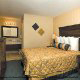 Luxury Hotel Bedroom with King Size Bed at 1st Inn Hotel in Branson, Missouri. Our beds are surprisingly comfortable to make your Christmas Getaway perfect.