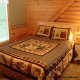 Bedroom with Night Stand in Cabin 20 (Eagles Roost) at Eagles Ridge Resort at Pigeon Forge, Tennessee.