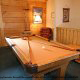 Game Room with Pool Table in Cabin 202 (Now And Forever) at Eagles Ridge Resort at Pigeon Forge, Tennessee.