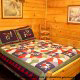 Bedroom with Full Size Bed in Cabin 203 (Kevins Haven) at Eagles Ridge Resort at Pigeon Forge, Tennessee.