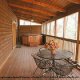 Deck with hot tub in cabin 207 (Count Your Blessings) at Eagles Ridge Resort at Pigeon Forge, Tennessee.