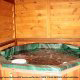 Hot Tub on Deck in Cabin 212 (Codys Comfort) at Eagles Ridge Resort at Pigeon Forge, Tennessee.