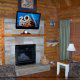 Living Room View with Fire Place in Cabin 22 (Beaver Lodge) at Eagles Ridge Resort at Pigeon Forge, Tennessee.