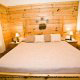 Bedroom with King Size Bed in Cabin 223 (Youngs Hideaway) at Eagles Ridge Resort at Pigeon Forge, Tennessee.