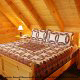 Bedroom with Queen Size Bed in Cabin 224 (Southern Comfort) at Eagles Ridge Resort at Pigeon Forge, Tennessee.