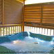 Porch View with Hot Tub of Cabin 232 (Mountain Spirits) at Eagles Ridge Resort at Pigeon Forge, Tennessee.