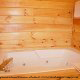 Bathroom View with Jacuzzi of Cabin 232 (Mountain Spirits) at Eagles Ridge Resort at Pigeon Forge, Tennessee.