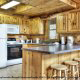 Large kitchen with bar in cabin 233 (Bear Creek Lodge) at Eagles Ridge Resort at Pigeon Forge, Tennessee.
