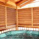 Deck with large hot tub in cabin 234 (Dancing Bear Lodge) at Eagles Ridge Resort at Pigeon Forge, Tennessee.