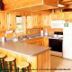 Large kitchen with bar in cabin 234 (Dancing Bear Lodge) at Eagles Ridge Resort at Pigeon Forge, Tennessee.