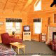 Living room with vaulted ceiling and fireplace in cabin 234 (Dancing Bear Lodge) at Eagles Ridge Resort at Pigeon Forge, Tennessee.