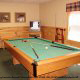 Game room with pool table in cabin 234 (Dancing Bear Lodge) at Eagles Ridge Resort at Pigeon Forge, Tennessee.