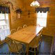 Large country dining room in cabin 241 (Eagle Crest Lodge) at Eagles Ridge Resort at Pigeon Forge, Tennessee.