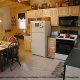 Fully furnished country kitchen in cabin 247 (Legacy Lodge ) , in Pigeon Forge, Tennessee.