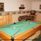 Game room with pool table in cabin 253 (Mt Richmond) at Eagles Ridge Resort at Pigeon Forge, Tennessee.