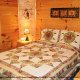 Country bedroom in cabin 255 (Happy Trails) at Eagles Ridge Resort at Pigeon Forge, Tennessee.