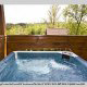 Deck with hot tub in cabin 255 (Happy Trails) at Eagles Ridge Resort at Pigeon Forge, Tennessee.