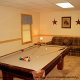 Game room with pool table in cabin 255 (Happy Trails) at Eagles Ridge Resort at Pigeon Forge, Tennessee.