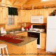 Fully furnished kitchen in cabin 259 (Country Charm) , in Pigeon Forge, Tennessee.