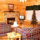 Living room with fire place in cabin 259 (Country Charm) , in Pigeon Forge, Tennessee.