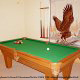 Game room with pool table in cabin 259 (Country Charm) , in Pigeon Forge, Tennessee.