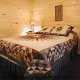Country bedroom in cabin 298 (Renewed Spirit) at Eagles Ridge Resort at Pigeon Forge, Tennessee.