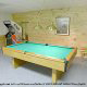 Game room with pool table in cabin 298 (Renewed Spirit) at Eagles Ridge Resort at Pigeon Forge, Tennessee.