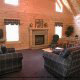 Great room with fireplace in cabin 298 (Renewed Spirit) at Eagles Ridge Resort at Pigeon Forge, Tennessee.