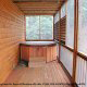 Deck with hot tub in cabin 298 (Renewed Spirit) at Eagles Ridge Resort at Pigeon Forge, Tennessee.