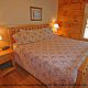 Bedroom with King Size Bed in Cabin 299 (Possum Hollow) at Eagles Ridge Resort at Pigeon Forge, Tennessee.