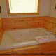 Private Jacuzzi View of Cabin 299 (Possum Hollow) at Eagles Ridge Resort at Pigeon Forge, Tennessee.