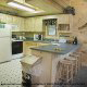 Kitchen View of Cabin 302 (Best Of Times) at Eagles Ridge Resort at Pigeon Forge, Tennessee.