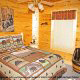 Country bedroom in cabin 305 (Bear Right In) at Eagles Ridge Resort at Pigeon Forge, Tennessee.
