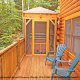 Back porch with hot tub in cabin 305 (Bear Right In) at Eagles Ridge Resort at Pigeon Forge, Tennessee.