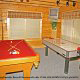 Game room with pool table in cabin 305 (Bear Right In) at Eagles Ridge Resort at Pigeon Forge, Tennessee.